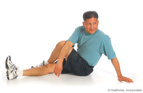 Picture of iliotibial band and buttock stretch (sitting)